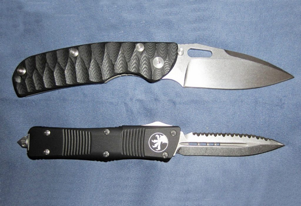 two microtech knifes